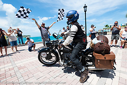 Richard Campbell riding his restored 1940 opposed twin Zundapp over the finish line of the Cross Country Chase motorcycle endurance run from Sault Sainte Marie, MI to Key West, FL. (for vintage bikes from 1930-1948). The Grand Finish in Key West's Mallory Square after the 110 mile Stage-10 ride from Miami to Key West, FL and after covering 2,368 miles of the Cross Country Chase. Sunday, September 15, 2019. Photography ©2019 Michael Lichter.