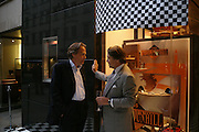 Earl  of March and Kinrara and Simon Critchell. Party to celebrate Alfred Dunhill at the Goodwood Festival of Speed. Dunhill shop. 48 Jermyn St. London SW1. 9 June 2005. ONE TIME USE ONLY - DO NOT ARCHIVE  © Copyright Photograph by Dafydd Jones 66 Stockwell Park Rd. London SW9 0DA Tel 020 7733 0108 www.dafjones.com