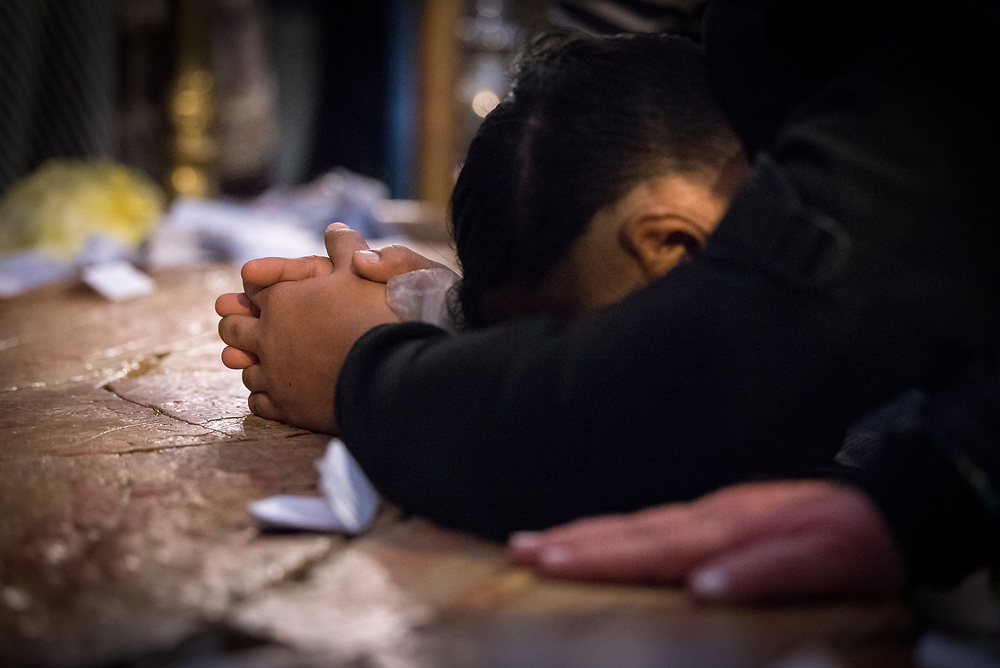 20 April 2019, Jerusalem: It is Palm Sunday in the eastern tradition, and Orthodox Christians gather to pray at the Stone of Anointing, where Jesus is said to have been prepared for burial in the Church of the Holy Sepulchre.