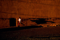 A child runs in the late light of the day in Trenton MO.