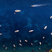 Yachts and boats in a harbour on the island of Capri, Italy.<br /> <br /> + ART PRINTS +<br /> To order prints or cards of this image, visit:<br /> http://greg-stechishin.artistwebsites.com/featured/capri-greg-stechishin.html