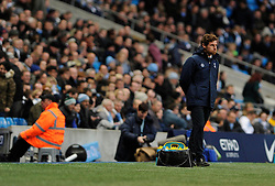 Tottenham Hotspur Manager, Andre Villas Boas blows his cheeks as Tottenham lose 6 - 0 - Photo mandatory by-line: Dougie Allward/JMP - Tel: Mobile: 07966 386802 24/11/2013 - SPORT - Football - Manchester - Etihad Stadium - Manchester City v Tottenham Hotspur - Barclays Premier League
