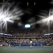 Novak Djokovic, Serbia, in action against Mikhail Youzhny, Russia, during the Men's SIngles Quarter Final match at the US Open. Flushing. New York, USA. 5th September 2013. Photo Tim Clayton