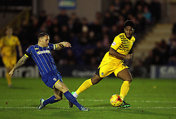 Barry Fuller of AFC Wimbledon passes the ball under pressure from Ellis Harrison of Bristol Rovers - Mandatory byline: Robbie Stephenson/JMP - 07966 386802 - 26/12/2015 - FOOTBALL - Kingsmeadow Stadium - Wimbledon, England - AFC Wimbledon v Bristol Rovers - Sky Bet League Two