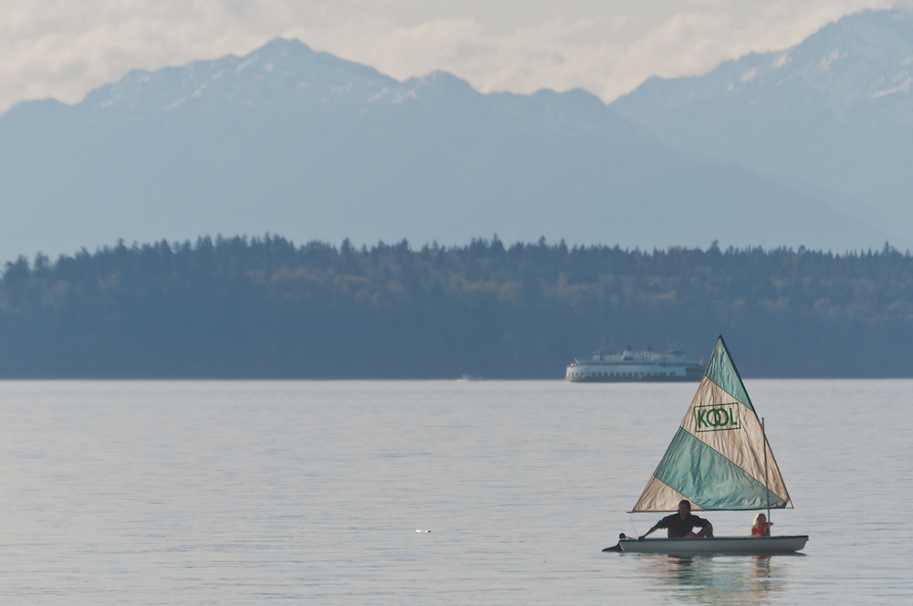 """Relaxing in a """"Kool"""" sail boat in Puget Sound, near West Point, West Seattle, Washington.  Photo By William Byrne Drumm."""