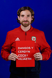 CARDIFF, WALES - Tuesday, October 9, 2018: Wales' Joe Allen holds a Dangos y Cerdyn Coch I Hiliaeth (Show Racism The Red Card) sign during a media session at the St Fagans National Museum of History ahead of the International Friendly match between Wales and Spain. (Pic by David Rawcliffe/Propaganda)