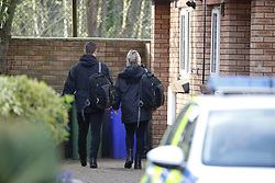 © Licensed to London News Pictures . 24/03/2017 . Manchester , UK . Two people believed to be police enter number 12 at the end of a terrace at Lawnside Mews.  Scene on Lawnside Mews in Didsbury , Manchester where police investigating Khalid Masood's terrorist attack in Westminster have arrested a 30 year old man . Photo credit: Joel Goodman/LNP