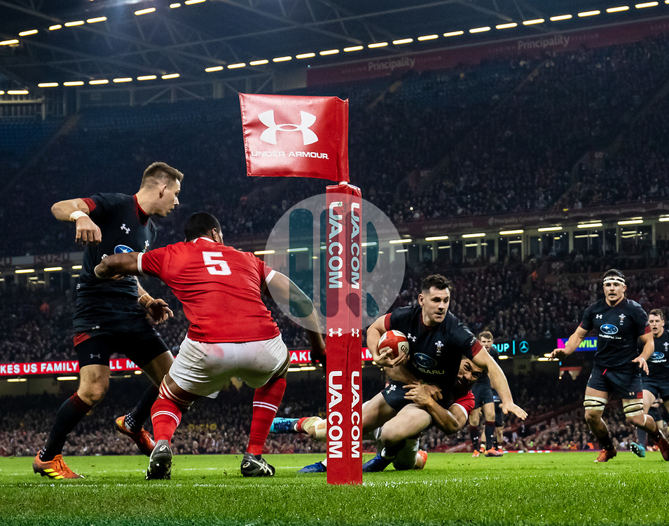 Tomos Williams of Wales scores his sides fifth try<br /> <br /> Photographer Simon King/Replay Images<br /> <br /> Under Armour Series - Wales v Tonga - Saturday 17th November 2018 - Principality Stadium - Cardiff<br /> <br /> World Copyright © Replay Images . All rights reserved. info@replayimages.co.uk - http://replayimages.co.uk