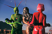 Participants at Burning Man are dressed as colored naked bicycles. Burning Man is a performance art festival known for art, drugs and sex. It takes place annually in the Black Rock Desert near Gerlach, Nevada, USA.