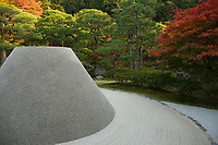 18. Ginkakuji 銀閣寺 is a Zen temple at the foot of Higashiyama Eastern Mountain. The temple was formally known as Tozan Jishoji as a retirement villa for shogun Ashikaga Yoshimasa. Its formal name  is Tozan Jishoji. The Silver Pavilion was constructed, modeled after is cousin Kinkakuji's Golden Pavilion.  The legend is that there were originally plans to cover the pavilion in silver but this never happened, even so the name Silver Pavilion stuck. The villa was converted into a Zen temple after Yoshimasa's death and is well known for its zen garden, parts of which are of more recent additions.  The unique Kogetsudai Moon Viewing Pavilion adds an enigmatic element to the surrounding horizontal sea of gravel.
