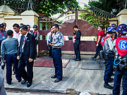 27 NOVEMBER 2017 - YANGON, MYANMAR: Myanmar police and security personnel in front of the Cardinal's residence in Yangon after Pope Francis arrived at the residence. Pope Francis arrived in Yangon Monday for a four day / three night visit. Tuesday he is going to the capitol, Naypyidaw (Nay Pyi Taw) to meet with Aung San Suu Kyi and other Myanmar leaders. Wednesday and Thursday he is saying mass in Yangon and on Thursday afternoon he is going to neighboring Bangladesh. There are around 450,000 Catholics in Burma, about 1% of the total population.   PHOTO BY JACK KURTZ