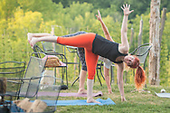 Westtown, New York - People participate in a Wild Soul Yoga Studio sunset yoga session at Westtown Brew Works on July 21, 2016.