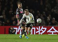 Football - 2019 / 2020 Sky Bet (EFL) Championship - Fulham vs. Leeds United<br /> <br /> Stuart Dallas (Leeds United) catches Tom Cairney (Fulham FC) at Craven Cottage<br /> <br /> COLORSPORT/DANIEL BEARHAM