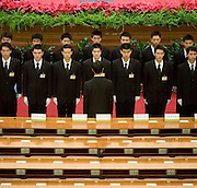 Attendants line up in a military formation after a session of the National People's Congress after a session in the Great Hall of the People. Chinese leaders are trying to improve energy efficiency to reduce both environmental damage and China's reliance on imported oil, which they see as a strategic weakness.