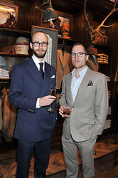 Left to right, SIMON CROMPTON and LUKE CARBY at a reception hosted by Ralph Lauren Double RL and Dexter Fletcher before a private screening of Wild Bill benefitting FilmAid held at RRL 16 Mount Street, London on 26th March 2012.