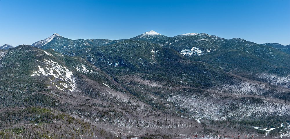 Great Range from Adams, Adirondacks, NY<br /> Out of breath, out of shape.  I probably would have been better off climbing one of the peaks I came to get a view of than this steep knob, so well situated downrange from them.  Once the trail begins to climb, it is an act of faith—no views to orient me, or lookouts to admire from...no excuses to stop the endless up.  The fire tower at the top is the only view.  I give a silent thanks that it is open and climb the steps against my usual fear of heights.   There are few trails on the southern part of the range, so an impressive wilderness spreads out before me.  I step to the windows like they are the edge of my future.  I wonder, these days, what the plan should be.  The way ahead is out there, beyond this range, beyond my sight.  I carry maps of trails, but not a map of the way.  It's a journey loosely conceived, swirling in a cloud of fate...I can't see it and for once I'm not confident.  I think a step into the unknown is always less dramatic than you imagine, because there are a thousand more that propel you forward.  I wish I had your hand to hold, the reassurance of a strong love and a deep resolve, a home for my heart.  But of course I don't, or I'd never leave.