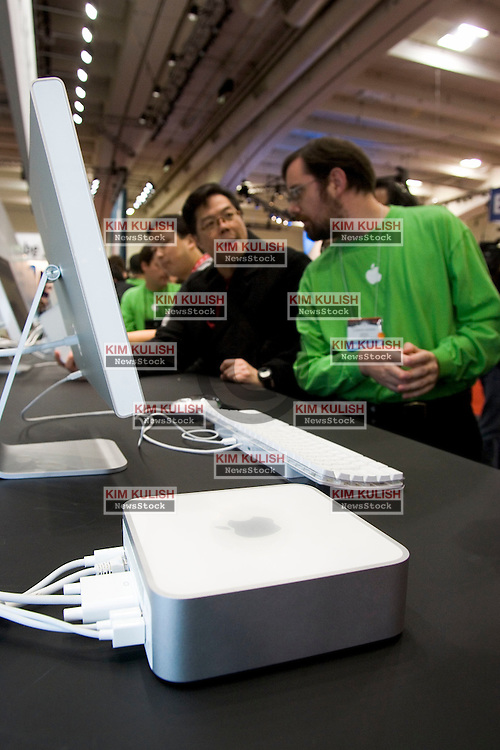 Attendees try out new Mac Mini computer's on display at the 2005 Macworld Expo January 11, 2005 in San Francisco, California. Steve Jobs announced several new products including the new Mac Mini personal computer starting at $499 and the iPod shuffle MP3 player for $99  Photo ©2005  by Kim Kulish