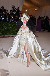 Cardi B walking the red carpet at The Metropolitan Museum of Art Costume Institute Benefit celebrating the opening of Heavenly Bodies : Fashion and the Catholic Imagination held at The Metropolitan Museum of Art  in New York, NY, on May 7, 2018. (Photo by Anthony Behar/Sipa USA)