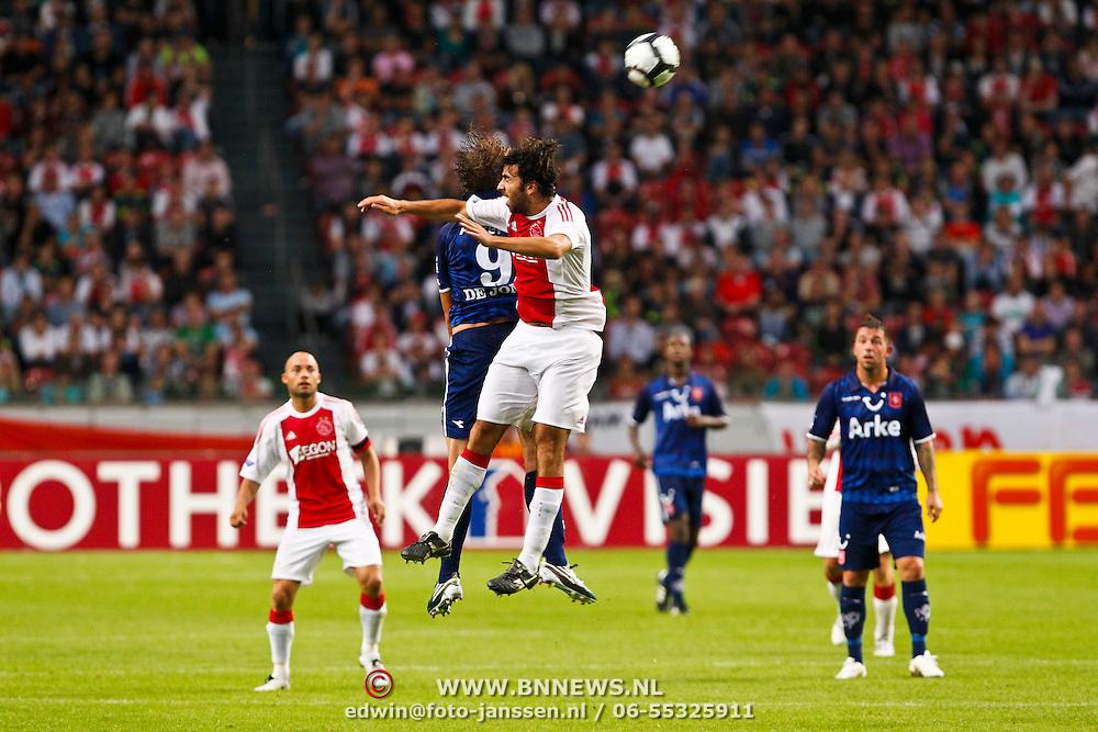 NLD/Amsterdam/20100731 - Wedstrijd om de JC schaal 2010 tussen Ajax - FC Twente, Oleguer Presas Renom in duel met Luuk de Jong