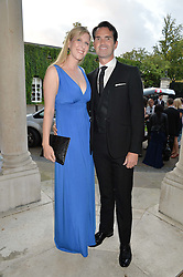 JIMMY CARR and KAROLINE COPPING at 'A Night of Champions' an evening to raise funds for the Mo Farah Foundation held at The Hurlingham Club, London on 28th August 2014.