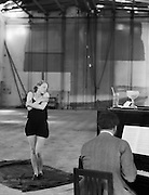 Brigitte Helm, actress rehearsing with piano at UFA Studios, 1928