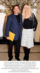 Chef RAYMOND BLANC and MISS NATALIA TRAXEL at a reception in London on 24th April 2003.	PJA 18