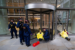 © Licensed to London News Pictures. 14/10/2019. London, UK. Extinction Rebellion protesters dressed as a canaries remain glued on to the Walkie Talkie building . Protesters are today targeting the financial district.  Photo credit: George Cracknell Wright/LNP
