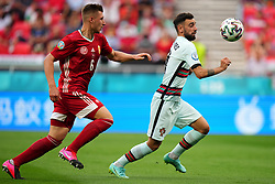 BUDAPEST, HUNGARY - JUNE 15: Bruno Fernandes of Portugal is closed down by Willi Orban of Hungary during the UEFA Euro 2020 Championship Group F match between Hungary and Portugal at Puskas Arena on June 15, 2021 in Budapest, Hungary. (Photo by Angel Martinez - UEFA)