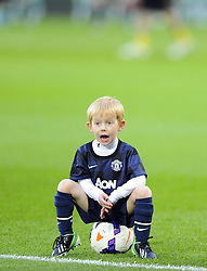 A Young Manchester United Mascot watches his heroes warm up - Photo mandatory by-line: Joseph Meredith/JMP - Tel: Mobile: 07966 386802 - 24/11/2013 - SPORT - FOOTBALL - Cardiff City Stadium - Cardiff City v Manchester United - Barclays Premier League.