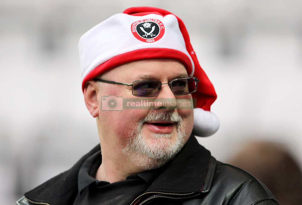 A Sheffield United fan with a Santa hat to show support for his team