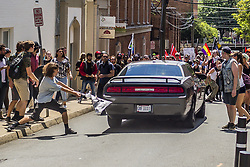 August 12, 2017 - Charlottesville, Virginia, U.S. - One counter-protester died after being struck by the vehicle. The driver of the car was caught fleeing the scene and the Governor of Virginia issued a state of emergency. white supremacist groups clashed with hundreds of counter-protesters during the 'Unite The Right' rally. Dozens were injured in skirmishes and many others after a white nationalist plowed his sports car into a throng of protesters. (Credit Image: © Michael Nigro/Pacific Press via ZUMA Wire)