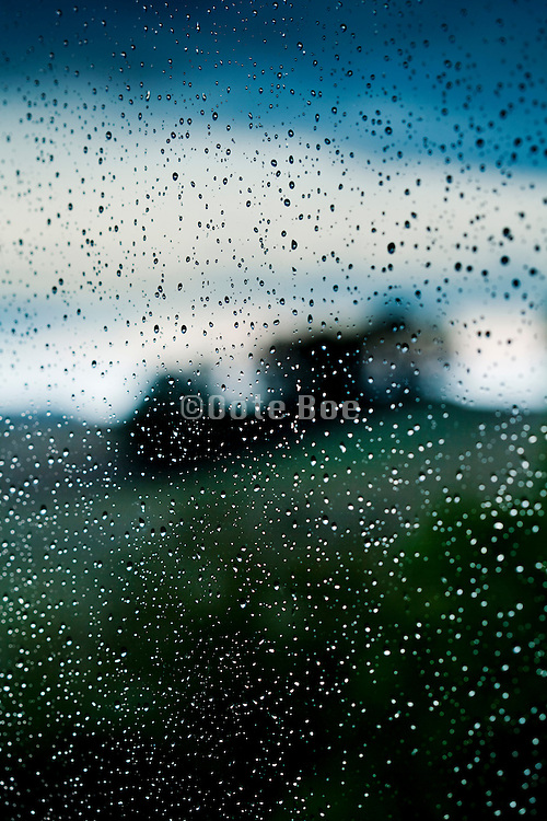 raindrops on window in rural setting