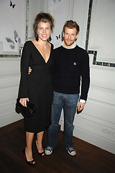 TOM & AMBER AIKENS at a party to launch the Dom Perignon OEotheque 1995 held at The Landau, Portland Place, London W1 on 26th February 2008.<br />