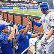 NEW YORK, NEW YORK - June 30: Kris Bryant #17 of the Chicago Cubs is congratulated by team mates as he returns to the dugout after hitting a two run home run in the first inning during the Chicago Cubs Vs New York Mets regular season MLB game at Citi Field on June 30, 2016 in New York City. (Photo by Tim Clayton/Corbis via Getty Images)