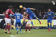 AFC Wimbledon defender Darius Charles (32) beating Northampton Town midfielder John-Joe O'Toole (21) to a header during the EFL Sky Bet League 1 match between AFC Wimbledon and Northampton Town at the Cherry Red Records Stadium, Kingston, England on 10 February 2018. Picture by Matthew Redman.