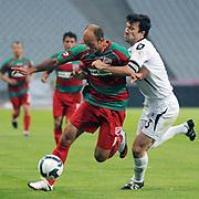 Karsiyakaspor's Okan OZTURK (L) and Altayspor's Onur NASUHOGULLARI (R) during their Play Off First leg match at Ataturk olympic Stadium in Istanbul Turkey on Monday, 17 May 2010. Photo by TURKPIX
