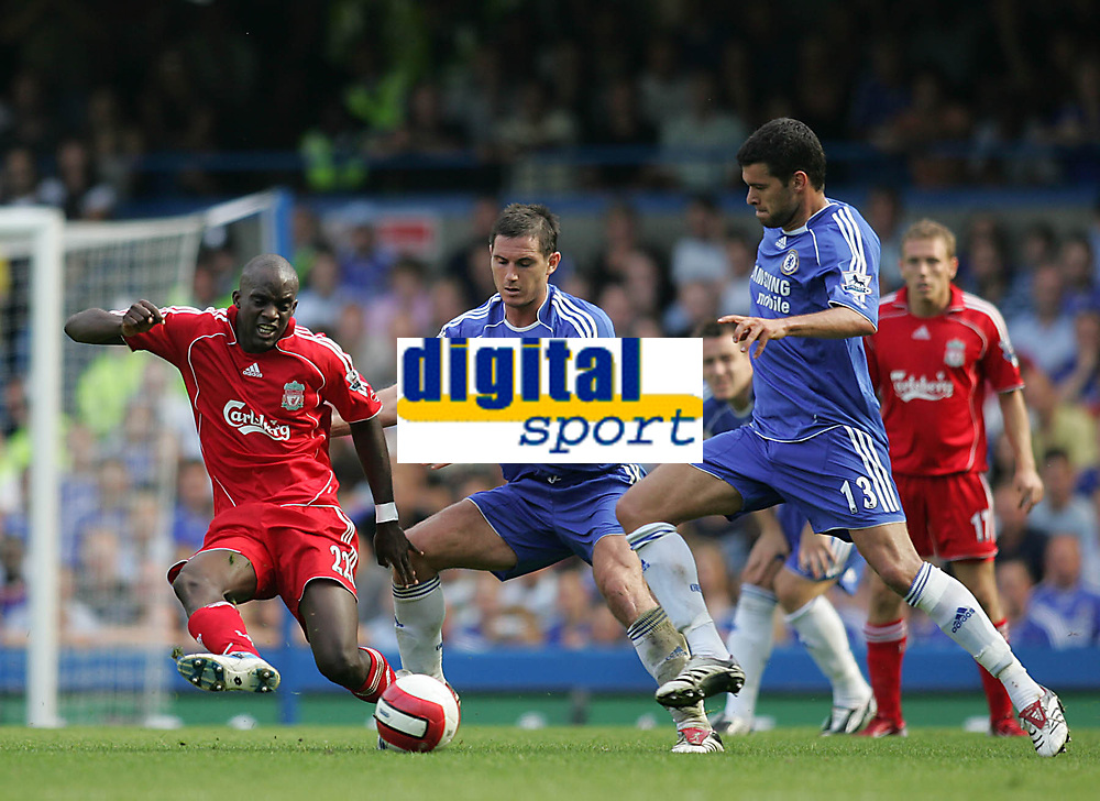 Photo: Lee Earle.<br /> Chelsea v Liverpool. The Barclays Premiership. 17/09/2006. Chelsea's Michael Ballack (R) goes in on Mohamed Sissoko (L) that lead to his sending off.