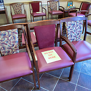Social distancing measures due to the Coronavirus (Covid-19) threat are seen on the patient waiting room chairs at Universal Medical Care on Tuesday, March 31, 2020 in Orlando, Florida. (Alex Menendez via AP)