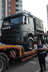 A Metropolitan Police officer monitors a small convoy of vehicles approaching ExCeL London during preparations for the DSEI 2021 arms fair on 6th September 2021 in London, United Kingdom. The first day of week-long Stop The Arms Fair protests outside the venue for one of the world's largest arms fairs was hosted by activists calling for a ban on UK arms exports to Israel.
