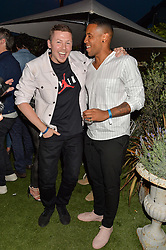 Left to right, PROFESSOR GREEN and REGGIE YATES at the Warner Music Group & GQ Summer Drinks hosted in asociation with Quintessentially at Shoreditch House, Ebor Street, London on 6th July 2016.