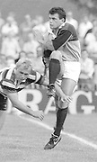 Bath, West Somerset. Great Britain.  Will CARLING, Breaking through, Andy ROBINSON's tackle, to clear the ball, during the Bath Rugby vs Harlequins, The Recreation Ground [Rec]. 10.09.1988.<br /> <br /> [Mandatory Credit, Peter Spurrier/ Intersport Images].
