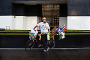 A Pro-EU protester with bicycle and covered with EU flags standing in front of the Parliament building at Parliament Square, London