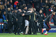 Manchester United interim Manager Ole Gunnar Solskjaer and Manchester United Assistant Manager Mike Phelan celebrate after the whistle in a huddle during the Champions League Round of 16 2nd leg match between Paris Saint-Germain and Manchester United at Parc des Princes, Paris, France on 6 March 2019.