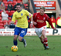 Photo: Dave Linney.<br />Walsall v Colchester United. Coca Cola League 1.<br />14/01/2006.<br />Colchester's John White (L) glides past Mads Timms.