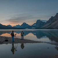 Photographers await the dawn beside Bow Lake in Banff National Park, Alberta, Canada. Behind (L to R) are Mount Andromache, Mount Hector, Bow Peak, Bow Crow Peak, and Crowfoot Mountain.