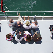 Passengers on the Devonport Ferry running from Auckland to Devonport.  Auckland, North Island, New Zealand. 26th November 2010. Photo Tim Clayton...