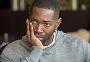 Photo by Mara Lavitt<br /> New Haven, CT<br /> May 11, 2017<br /> Yale School of Drama incoming chair of the playwriting department, Tarell Alvin McCraney, meets with third-year playwriting students. At the Study Hotel, New Haven.