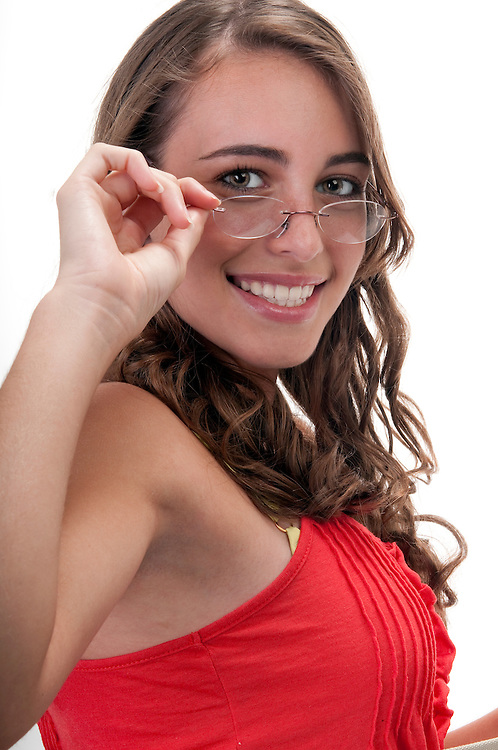 Portrait of teenager with eyeglasses very happy and smiling.