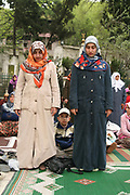 Turkish women at prayer in a mosque in Istanbul, Turkey