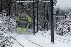© Licensed to London News Pictures. 21/01/2013, London, UK. A tram runs along snow covered tracks in Croydon, South London, Monday, Jan. 21, 2013. Britain is continue affect by cold weather and snow. Photo credit : Sang Tan/LNP